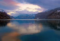 SWISS MOUNTAINS LAKE SUNSET, SWITZERLAND Royalty Free Stock Image