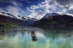 SWISS MOUNTAINS LAKE, SWITZERLAND. Alpine sunny lake in Switzerland Stock Photography