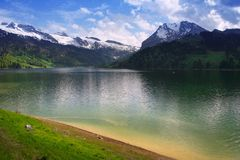 Swiss mountains lake, Switzerland. Sunny day in swiss mountains lake Wagitallersee Royalty Free Stock Photography