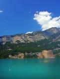 SWISS MOUNTAINS LAKE WALENSEE, SWITZERLAND. Alpine sunny lake in Switzerland Royalty Free Stock Photos