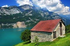 SWISS MOUNTAINS LAKE WALENSEE, SWITZERLAND. Alpine sunny lake in Switzerland Royalty Free Stock Images