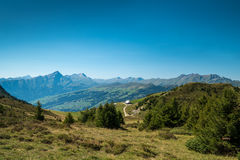 Swiss mountains, landscape and forest. Switzerland in all its glory - showing the mountains, forests, a little hut and a beautiful landscape Royalty Free Stock Images