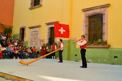 Swiss musician plays alphorn at Festival Cultural. Zacatecas, Mexico, 01 August 2013: Unidentified musician from Switzerland plays a traditional alphorn on stage Stock Image
