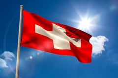 Swiss national flag on flagpole Stock Photography