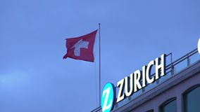 Swiss national flag flapping on top of building in Zurich, travel to Switzerland. Stock footage stock footage