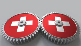 Swiss national project. Flags of Switzerland on moving cogwheels. Conceptual animation. Swiss national project. Flags of Switzerland on moving cogwheels stock video