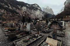Swiss old graveyard in the alps. stock photo