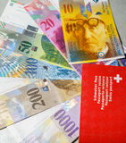 Swiss passport and money Stock Image