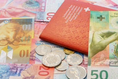 Swiss passport and Swiss Francs with New 20 and 50 Swiss Franc bills. Swiss passport and Swiss Francs and coins with New twenty and fifty Swiss Franc bills stock photography