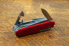 Swiss Penknife on oak table. High quality European multi tool on a good wood surface Stock Image
