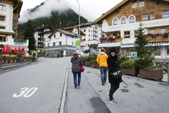 Swiss people and foreigner traveler travel rest and shopping duty free at shop in Samnaun. Village near Alps mountain on September 2, 2017 in Graubunden Royalty Free Stock Image