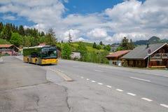 Swiss Post bus in the Swiss alps, Les Mosses, Switzerland stock photos