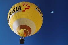 Swiss Post hot Air Balloon. Chateau d'Oex, Switzerland, January 22nd - 30th January , 2011 - The yellow Swiss Post hot Air Balloon at the Annual International Royalty Free Stock Image