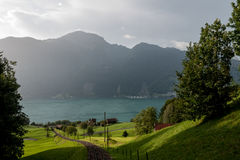 Swiss railway. Small cable railway goes to the lake in rural area of Switzerland stock photo