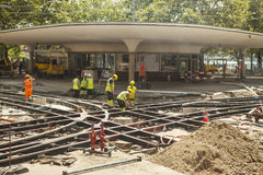 Swiss road construction workers working on the tram rails. Royalty Free Stock Photo