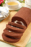 Swiss Roll. On the wooden cutting board Stock Images