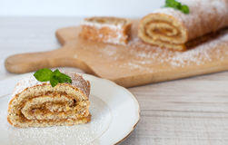 Swiss roll biscuit with pumpkin and apricot filing Royalty Free Stock Photo