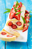 Swiss roll cake with strawberries Royalty Free Stock Photo