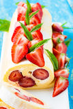 Swiss roll cake with strawberries Royalty Free Stock Images