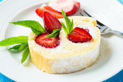 Swiss roll cake with strawberries Royalty Free Stock Photography