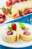 Swiss roll cake with strawberries Stock Photos