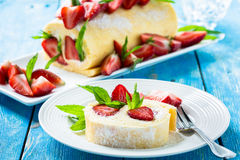 Swiss roll cake with strawberries Stock Photo
