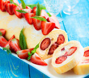 Swiss roll cake with strawberries Royalty Free Stock Photos