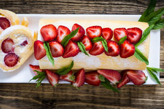 Swiss roll cake with strawberries Stock Images