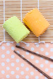 Swiss roll and chopsticks on tablecloth Royalty Free Stock Image