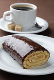 Swiss roll and coffee Stock Photo