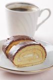 Swiss roll and coffee Royalty Free Stock Photos