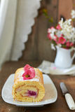 Swiss roll with cream. And raspberries Royalty Free Stock Photography