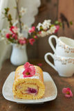 Swiss roll with cream. And raspberries Royalty Free Stock Photo