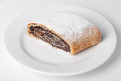 Swiss roll on the dish. Delicious swiss roll on the white plate Stock Photos