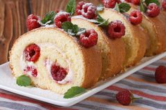 Swiss roll with raspberry and mint close up horizontal Stock Photo