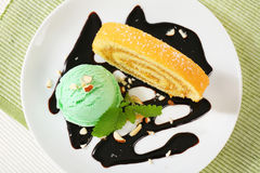 Swiss Roll with scoop of green sherbet Royalty Free Stock Image
