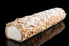 Swiss roll of whipped cream and almonds Royalty Free Stock Images
