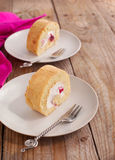 Swiss roll with whipped cream and black currant jam Stock Images