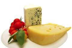 Swiss and roquefort cheese triangles and tomatoes Royalty Free Stock Image