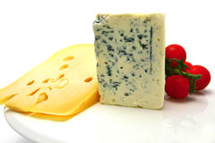 Swiss and roquefort cheeses and cherry tomato Stock Images