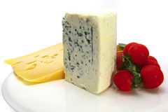Swiss and roquefort cheeses and tomato Stock Images