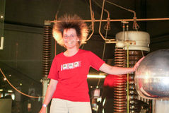 The Swiss Science Center Technorama at Winterthur, Switzerland. Winterthur, Switzerland - 13 april 2007: girl playing with the Van Der Graaf generator of the Stock Image