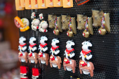 Swiss souvenirs. Rows of magnets depicting cows, fondue in Swiss souvenir shop, Gruyere, Switzerland. Gruyères is a town in the district of Gruyère in the Stock Illustration