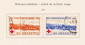 2 Swiss Stamps in Collector`s Album from 1939. SEATTLE, WASHINGTON - June 11, 2019: Collection of Swiss stamps from 1939 depicting a view of Geneva in red and royalty free stock photography