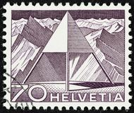 Swiss Stamps with Pyramids issued 1949. SEATTLE WASHINGTON - June 24, 2019:  Macro photograph of 70 centime Swiss stamp featuring pyramid graphic, issued in royalty free stock image