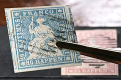 Swiss Strubel stamp. Linen tester with Swiss 10 Rappen Strubel stamp royalty free stock photo