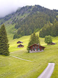 Swiss styled huts in the alps valley Stock Image