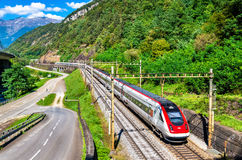 Swiss tilting high-speed train on the Gotthard railway. Anzonico, Switzerland - September 25, 2016: Swiss RABDe 500 tilting high-speed train on the Gotthard Royalty Free Stock Photography