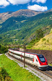 Swiss tilting high-speed train on the Gotthard railway. Faido, Switzerland - September 25, 2016: Swiss RABDe 500 tilting high-speed train on the Gotthard railway Stock Image