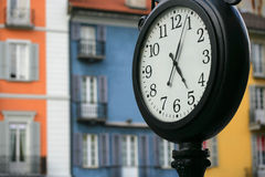 Swiss time. Street clock at five pm, in Locarno Switzerland royalty free stock images